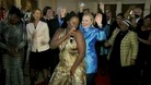 US Secretary of State Hillary Clinton dances at a dinner in South Africa
