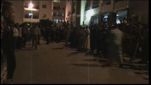 Residents gather outside the hospital in Al Arish city