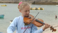 Young busker raises £52,000 for children's charity