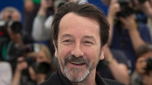 Actor Jean-Hugues Anglade sustained minor injuries to his hand by breaking the glass to sound the alarm