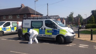 Forensics investigate at the scene of the murder