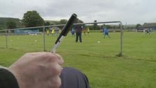 pen in front of football game