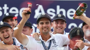 England captain Alastair Cook celebrates with team-mates after lifting the Ashes urn