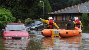 RNLI crews rescue residents of Morpeth, Northumberland, during the floods of 2008