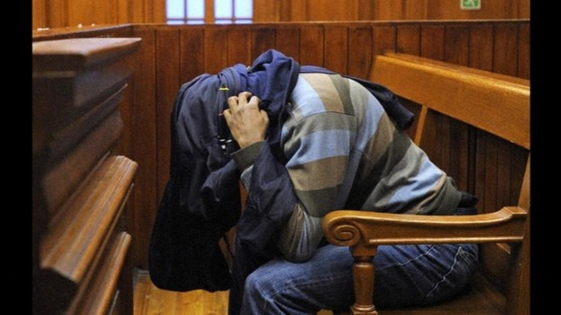 Mziwamadoda Qwabe hides his face at today's hearing