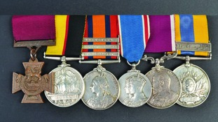 The medals include a replica Victoria Cross