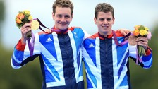 Great Britain&#x27;s Brownlee brothers celebrate their Olympic medals on Tuesday.