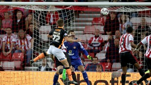 David Wheeler scores Exeter City's second goal of the match