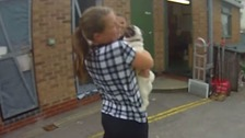 Lola showers her owner with kisses after being reunited