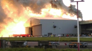 Picture from the Twitter feed of Dublin Fire Brigade of smoke billowing from a hangar at Dublin Airport