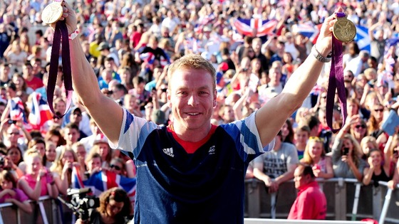 Sir Chris Hoy shows off his gold medals at BT London Live in Hyde Park.