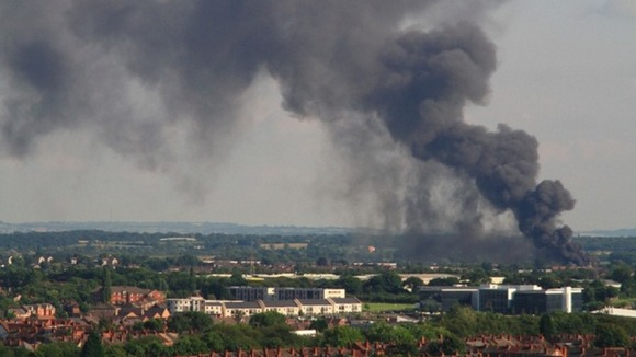 Fire services are trying to tackle a huge warehouse fire in Coventry ...