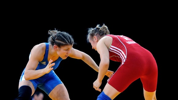 Great Britain's Olga Butkevych (left) competes in the -55kg freestyle event.