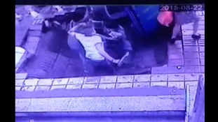CCTV captures moment sinkhole opens up under pedestrians in China