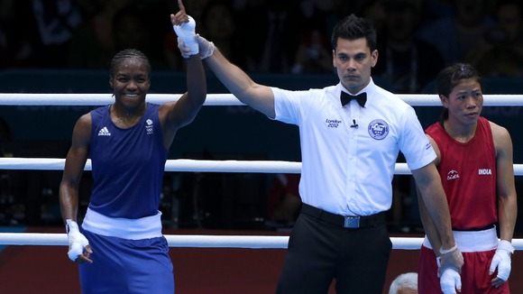 Great Britain's Nicola Adams (left) defeats India's Chungneijang Mery Kom Hmangte during the Women's Boxing Fly (48-51kg) Semi Final