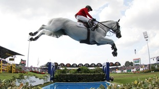 Meredith Michaels-Beerbaum of Germany rides her horse Fibonacci in the first round of the Show Jumping Team Final Competition during the FEI European Championships