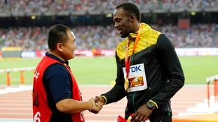 Usain Bolt makes up with Chinese cameraman after World Championships crash