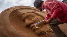 A sculptor working on the artwork