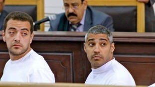 Journalists Baher Mohamed, (left), and Mohamed Fadel Fahmy, (right).