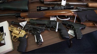 Guns of different sorts are displayed at the RCMP detachment