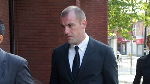 Everton footballer Darron Gibson arrives at Trafford Magistrates' Court.