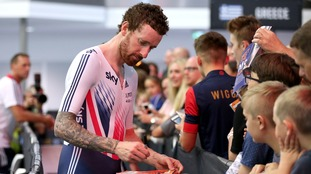 Team Great Britain's Sir Bradley Wiggins signs autographs for fans after winning the Madison during day three of the Revolution Series at Derby Arena.