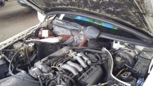 Migrant found next to engine in car.
