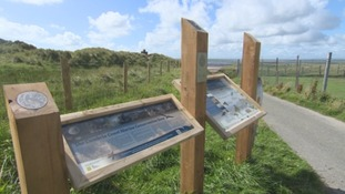 Interactive tourist boards have been installed along the coastline.