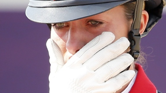 Gold medallist Charlotte Dujardin cries after winning the equestrian Dressage Individual Grand Prix Freestyle at Greenwich Park.