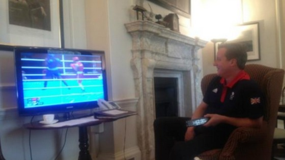 Prime Minister David Cameron watches Britain&#x27;s Nicola Adams win Olympic gold.