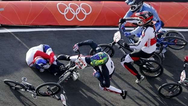 France's Joris Daudet and Nicholas Long of the US fall during the men's BMX quarter-final run