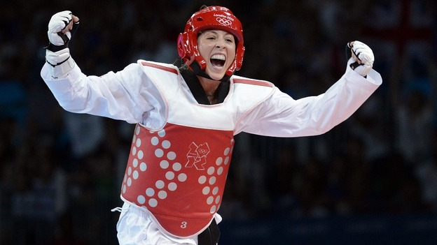Jones celebrates after defeating South Korea's Li-Cheng Tseng in the under -57kg semi-final.