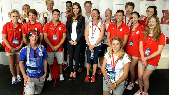 The Duchess of Cambridge and Prince Harry pose with athletes at Team GB House.