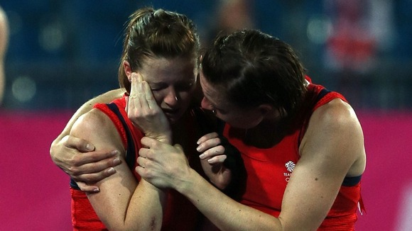 Great Britain's Helen Richardson is consoled by Kate Walsh (right) after defeat to Argentina in the semi-finals.