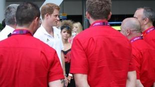 Prince Harry talks to volunteers.