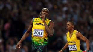 Bolt cruises past the finishing line.