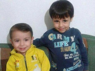 This photo is believed to show Aylan (left) and Galip Kurdi (right).