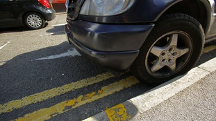 Cars parked poorly could be a road hazard