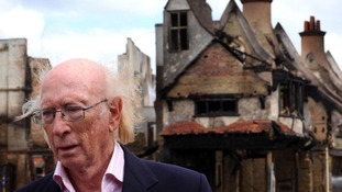 Maurice Reeves pictured outside his destroyed House of Reeves store
