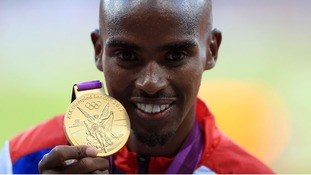 Great Britain's Mo Farah receives his gold medal for the men's 10,000m final