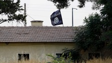 An Islamic State flag flies over the custom office of Syria's Jarablus border.