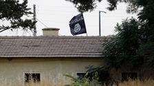 An Islamic State flag flies over the custom office of Syria's Jarablus border.