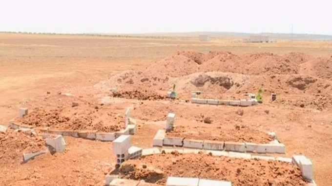 The final resting place of the Kurdi family in Kobane.