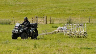 A motorised magnetometer system being used to survey the land around Stonehenge.