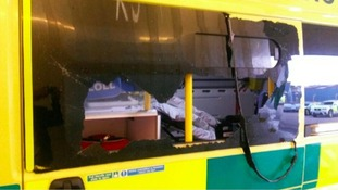 The smashed window of an ambulance