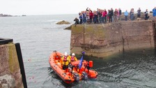 The lifeboat leaving the station.