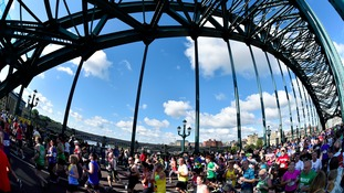Runners pass over the Tyne Bridge during 2014 Bupa Great North Run.