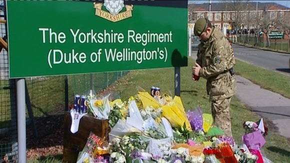 Flowers at the base of Yorkshire regiment barracks
