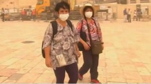 Tourists in Israel have been forced to wear masks