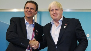 Mayors Eduardo Paes of Rio de Janeiro and Boris Johnson of London shake hands during a news conference